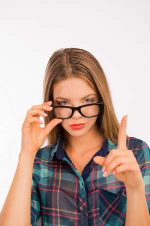 fashion girl style: Sexy girl with glasses showing her forefinger