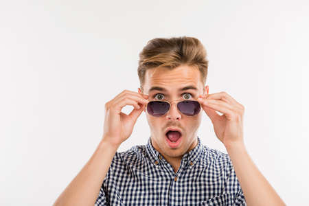 surprised man putting off his glasses Stock Photo