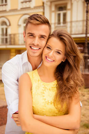 Nice couple in love on the background of buildings Stock Photo