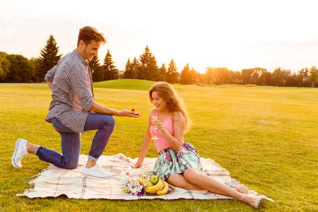 young man makes a proposal of betrothal to his girlfriend Stock Photo - 46390107