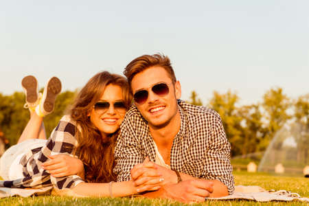 lovers park: lovers lying on the grass with glasses Stock Photo