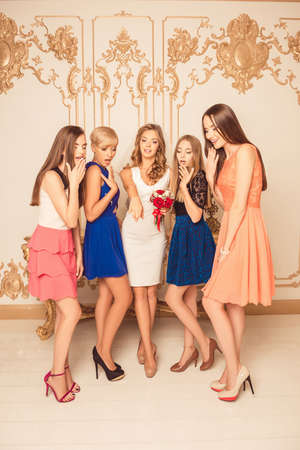bridesmaids: Cheerful bride showing her bridesmaids wedding ring Stock Photo