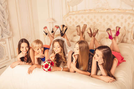 liying: cute girls celebrating a bachelorette party of bride liying on the bed Stock Photo