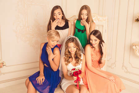 surprise party: cheerful girls celebrate a bachelorette party of bride