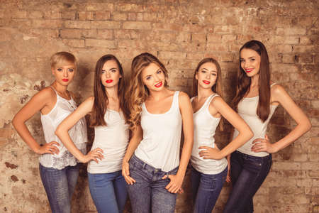 up code: Good-looking young women with red lips wearing dress code Stock Photo