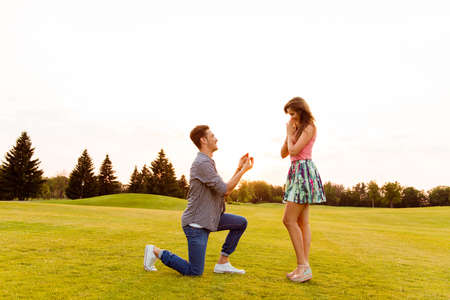 proposal of marriage: young man makes a proposal of betrothal to his girlfriend