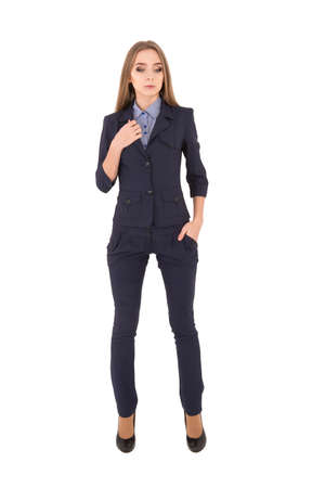 successful woman: Young successful woman in a business suit on a white background. serious girl put her hand in her pocket
