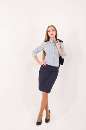 business attire teacher: girl in a business suit on a white background