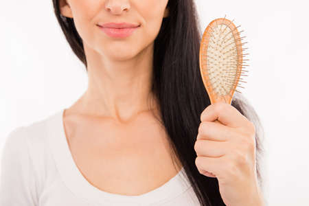 woman white shirt: Happy cute young woman holding hairbrush
