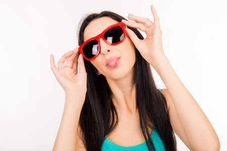 funny glasses: Funny young asian woman with red glasses showing tongue Stock Photo