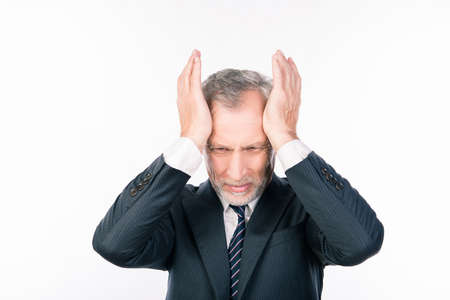 bad leadership: Terrible headache. Old man in suit touching his head and keeping eyes closed