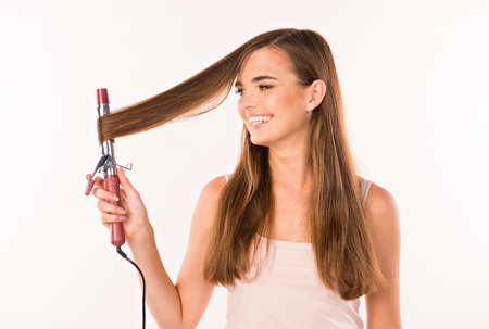 salve: girl spinning on curling her hair and smiling