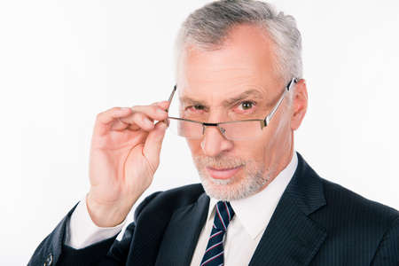 old black man: old businessman in a suit and tie down points on the nose