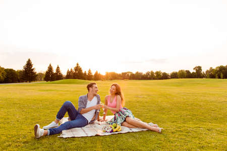 romantic man: man and woman talking on a romantic picnic