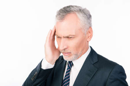 head pain: Old man suffering of headache in business suit