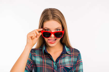 funny glasses: Cheerful girl with funny red glasses showing tongue