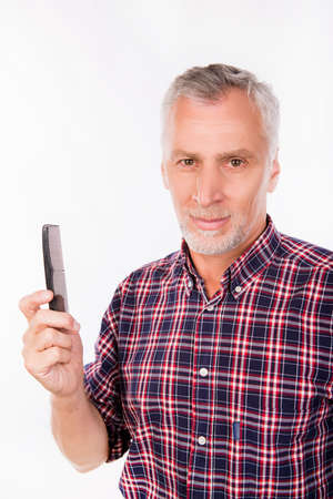 senior men: Confident aged man holding a comb Stock Photo