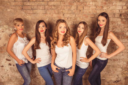 up code: Nice-looking young women with red lips wearing a dress code