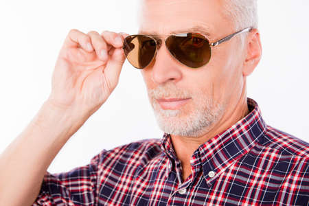 aged: Gray handsome aged man holding his sunglasses Stock Photo