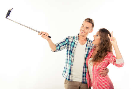 making love: Funny couple in love making selfie photo with selfie stick