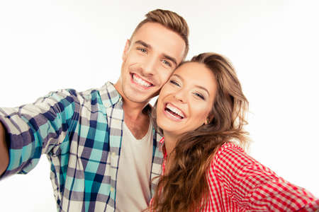 making fun: Happy pretty couple in love making selfie