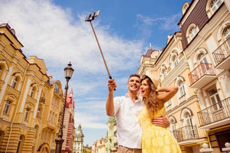 street love: couple in love making selfie photo on self stick