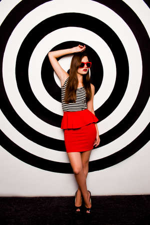 basque woman: Glamorous girl with glasses in a red skirt-basque against the background of circles