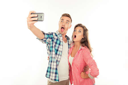 making love: Funny couple in love making selfie photo with smartphone