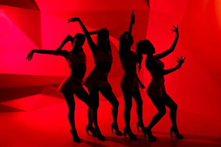 hen party: Silhouettes of four slim dancing girls Stock Photo