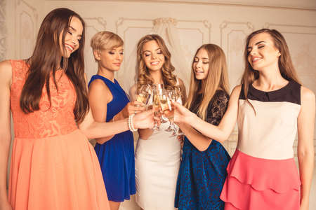 hen party: Cute young women celebrating hen party with sparkling wine