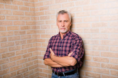 handsome old man: Handsome old man standing near the corner Stock Photo