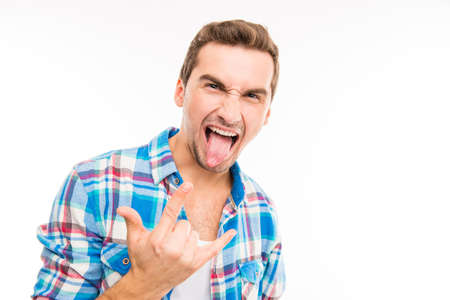 ridiculous: Handsome funny man aping gesturing rock Stock Photo