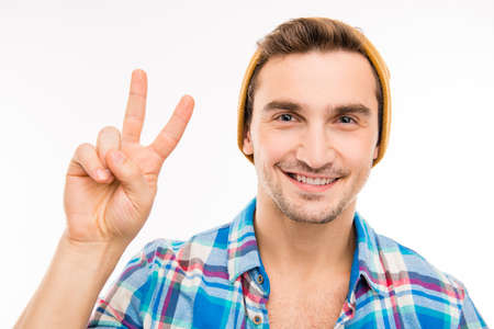 gesturing: Cute handsome young man gesturing two fingers Stock Photo