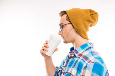 Side view of a handsome man with glasses cocktail and hat Stock Photo