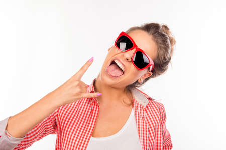 funny hair: Cool funny sexy girl with glasses gesturing two fingers