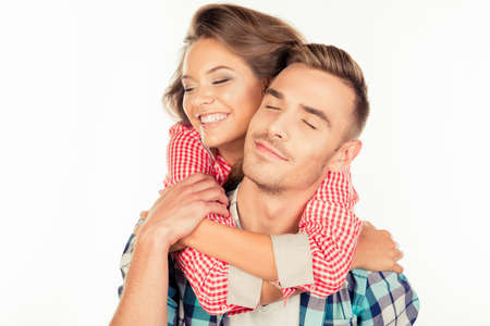 eyes closing: Pretty young woman embracing her boyfriend closing eyes Foto de archivo