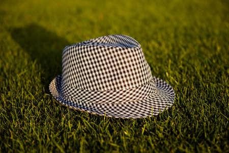unisex: Grey unisex striped hat on the grass