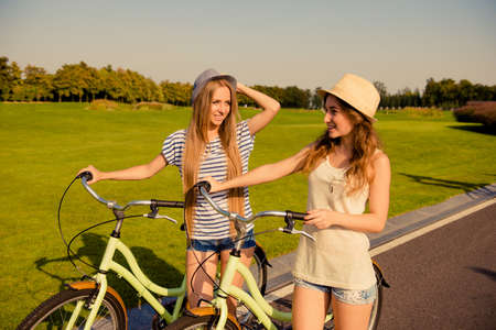lesbian love: happy lesbian couple together to ride a bicycle
