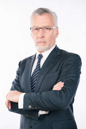 gray beard: handsome confident  businessman with gray beard and glasses crossing hands