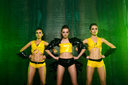 sexy pose: Three sexy confident cute girls in stage costumes