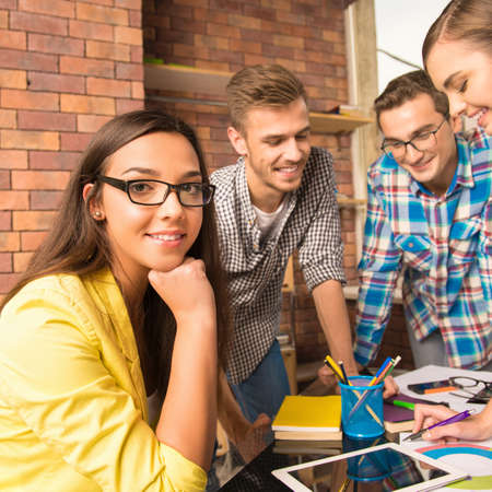 businessplan: Young active team working together on the task