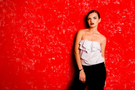 pomatum: Pretty glamorous young woman against the red background