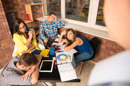 businessplan: Young tired team getting task from a boss