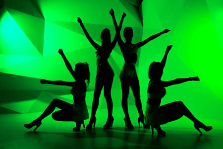 sexy girls party: Silhouettes of four slim posturing girls