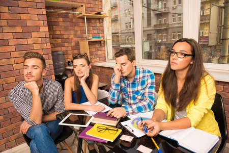 businessplan: Tired team working with a business project Stock Photo