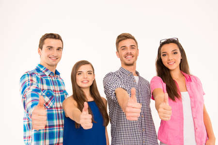businessplan: Closeup photo of cheerful young people standing showing thumbs up