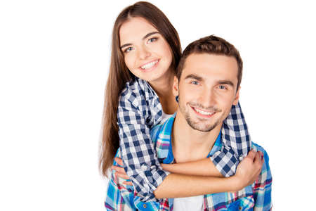 guy portrait: Pretty young woman embracing her boyfriend