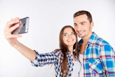 making love: Cheerful pretty couple in love making selfie Stock Photo