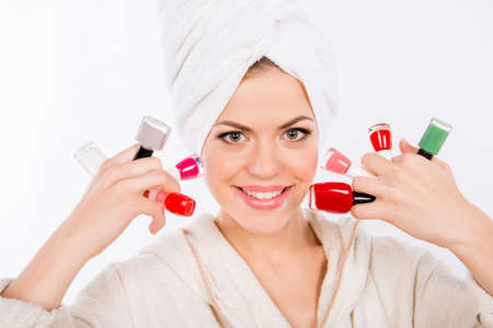 esthetics: Close-up portrait of a toyng girl with nail laquers Stock Photo