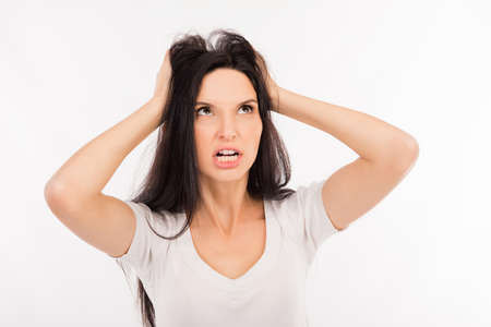 crazy girl: Portrait of crazy girl shouting and holding hair Stock Photo